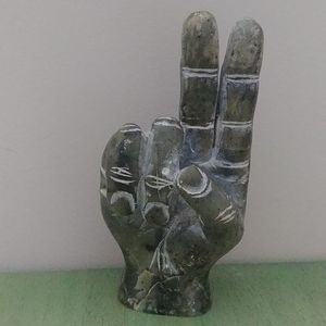 Stone sculpture of hand with peace sign